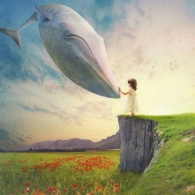 garota sonhando com mudança de vida em forma de baleia branca gigante
